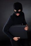 在计算机上的夜贼 库存图片