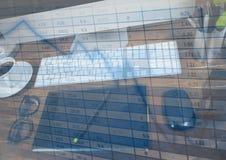 在计算机和蓝色图表覆盖物的图形输入板 图库摄影