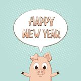在讲话泡影的新年快乐与在蓝色backgrou的小的猪 免版税图库摄影
