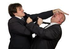 在论据期间的两个恼怒的企业同事,隔绝在白色背景 免版税库存照片