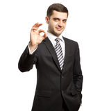 在诉讼的愉快的生意人显示得好 免版税图库摄影
