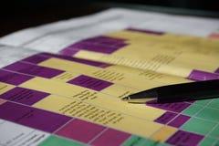 在详细的五颜六色的时间安排的假日计划 库存照片