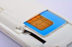 在调制解调器的西姆卡片 库存照片