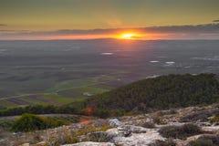 在谷上的日落 库存照片