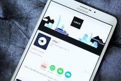 在谷歌戏剧的Uber出租汽车app 免版税库存图片