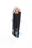 在象网的配件箱的铅笔在空白背景 库存图片