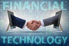 在财政tecnology fintech概念的两个人握手 库存照片