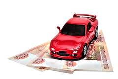 在货币的红色汽车 免版税库存照片