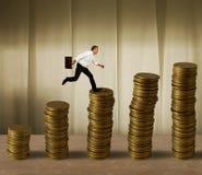 在货币的跳的生意人 库存照片
