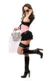 在购物以后的嬉戏的美丽的少妇。 查出 免版税库存图片