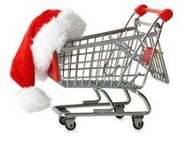 在购物车的圣诞老人帽子 免版税库存照片