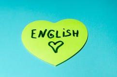 在贴纸写的英语以心脏的形式 免版税库存照片