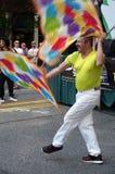 在资本自豪感节日的旗子舞蹈 库存照片