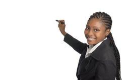 在赠送阅本spave的非洲女商人文字 免版税库存图片