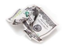 在起皱纹的白色背景的100美元 免版税库存照片
