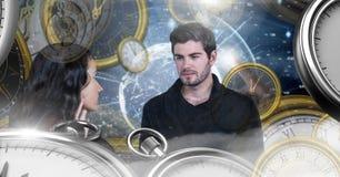 在超现实的时间和空间的夫妇与时钟 库存照片