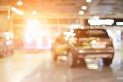 在超级市场弄脏汽车的背景,浅深度o 免版税库存图片