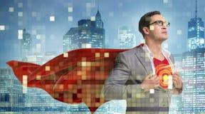 在超级英雄概念的商人与红色盖子 库存照片