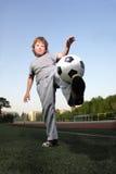 在足球的男孩作用 免版税库存照片