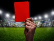 在足球的红牌 免版税库存照片
