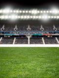 在足球竞技场的聚光灯 库存照片
