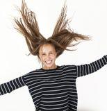在跃迁的年轻秀丽女孩飞行 免版税库存照片