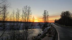 在路的冬天日落 库存照片