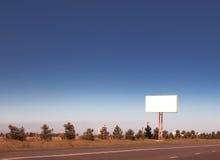 在路的广告牌 免版税库存照片
