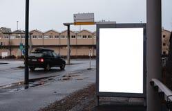 在路的空白的广告盘区牌 免版税库存照片