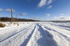 在路的雪,冬天 免版税库存照片