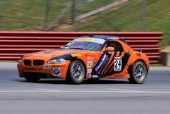 在路线的专业BMW Z4赛车 免版税库存照片