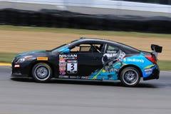 在路线的赞成日产Altima赛车 免版税库存照片