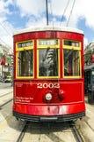 在路轨的红色台车路面电车 免版税图库摄影