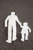 在路面的家庭标志 免版税图库摄影