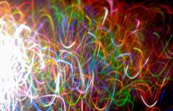 在跳舞在atm的美好的颜色的波浪,潦草书写闪电 免版税图库摄影