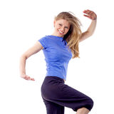 在跳舞姿势的性感的女性有氧运动/健身教练员 免版税库存照片