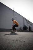 在踩滑板附近 免版税图库摄影