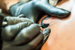 在身体的纹身花刺 库存图片