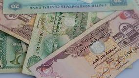 在转动的表面背景的阿拉伯金钱迪拉姆 股票录像