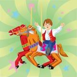 在转盘的男孩骑马 免版税图库摄影