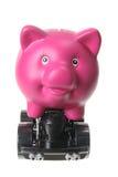 在轮子的Piggybank 库存图片