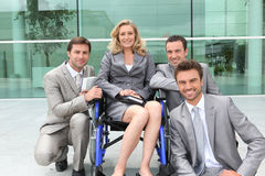 在轮椅的女性执行委员 免版税库存图片