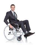 在轮椅的新生意人 库存照片