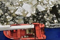 在轮渡的救生艇在冻波罗的海 库存照片