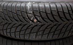 在轮胎的钉子 库存图片