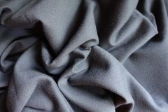 在软的折叠的简单的灰色织品 库存图片