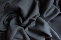 在软的折叠的简单的黑织品 库存照片