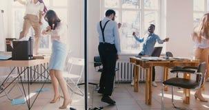 在轻的现代办公室聚会的慢动作愉快的乐趣不同种族的商人舞蹈,一起庆祝成就 股票视频