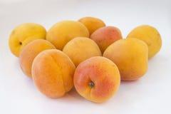 在轻的背景的杏子 库存照片
