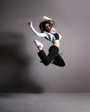 在运动的衣裳的年轻人和适应妇女跳舞 图库摄影